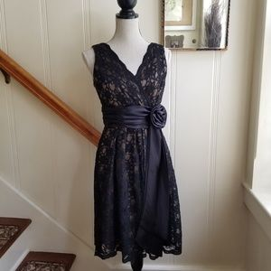 Black lace overlay cocktail dress with satin sash